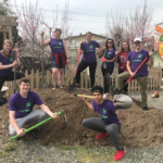 Young adults planting trees for earth day