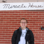 Patrick Sanders standing in front of Miracle House