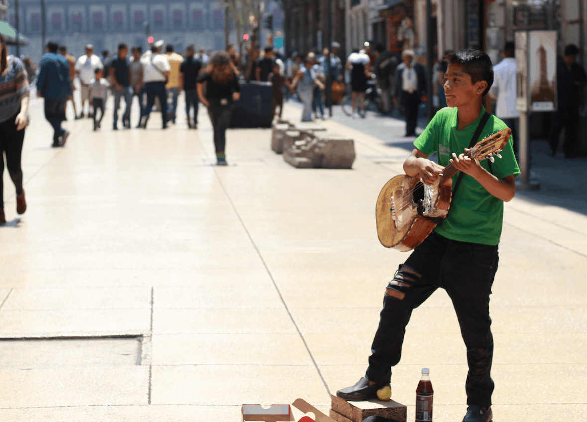 Boy playing guitar in Mexico on Cinco de Mayo