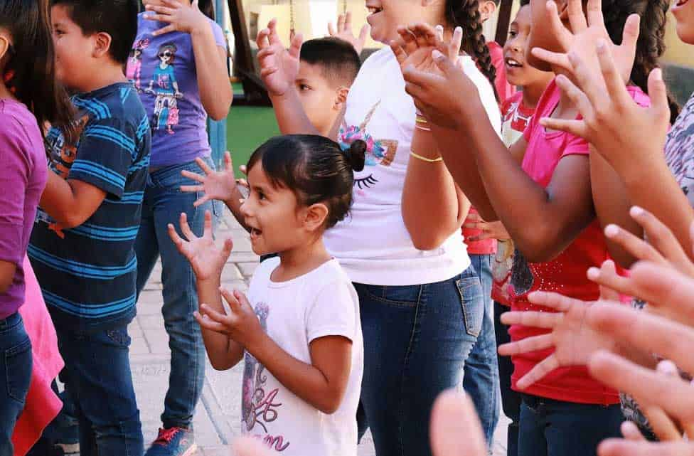 The cast of Up with People volunteers abroad in Mexico helping children in elementary schools