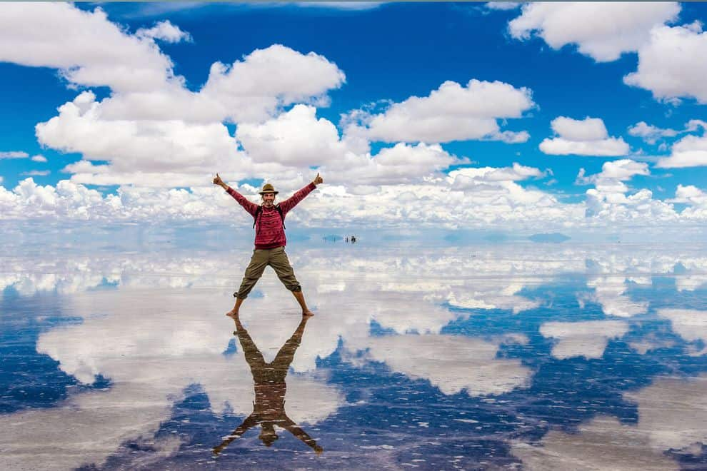 Man standing on the Bolivian Salt Flats for Summer Vacation
