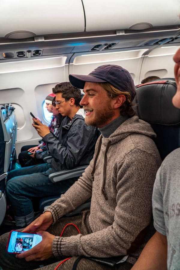 student traveling on airplane